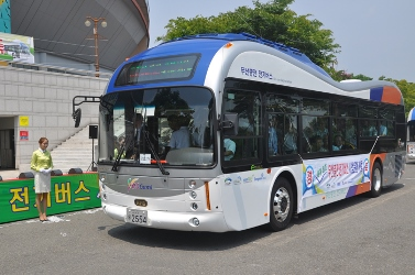 Two buses are equipped to recharge while driving over this roadway; the OLEV buses have coils on their underside to pick up power through the electromagnetic field on the road.